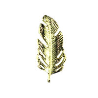 Gold feather pin