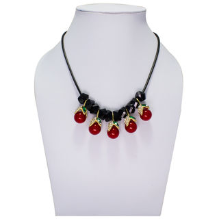 Black Necklace Adorned With Green Stones And Red Pearl